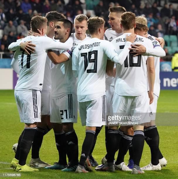 Germany's midfielder Ilkay Gundogan celebrates scoring with his teammates during the Euro 2020 qualifier Group C Estonia v Germany in Tallinn Estonia...