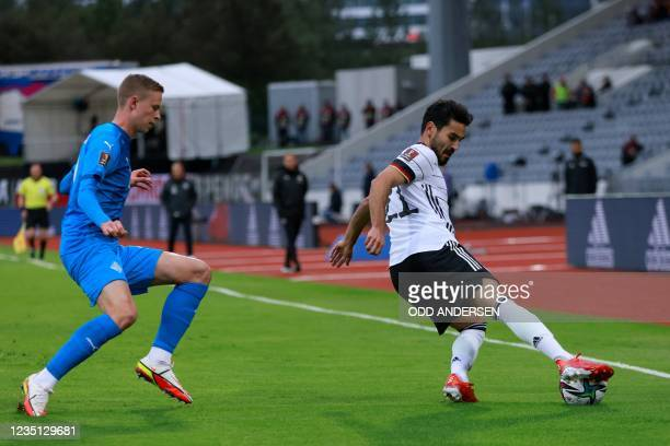 Germany's midfielder Ilkay Gundogan controls the ball during the FIFA World Cup Qatar 2022 qualification Group J football match between Iceland and...
