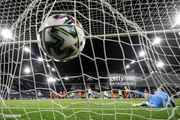 Germany's midfielder Ilkay Gundogan scores the 1-1 from the penalty spot past North Macedonia's goalkeeper Stole Dimitrievski during the FIFA World...