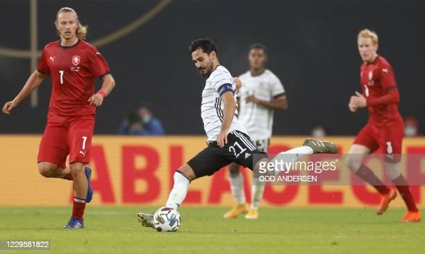Germany's midfielder Ilkay Gundogan shoots during the international friendly football match Germany v Czech Republic in Leipzig, eastern Germany on...