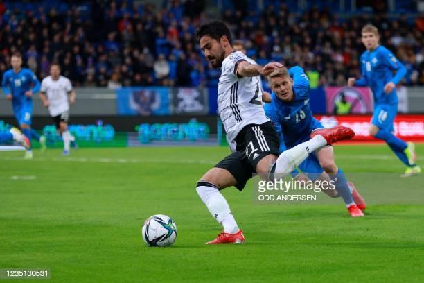 Germany's midfielder Ilkay Gundogan vies for the ball with Iceland's defender Ari Skulason during the FIFA World Cup Qatar 2022 qualification Group J...