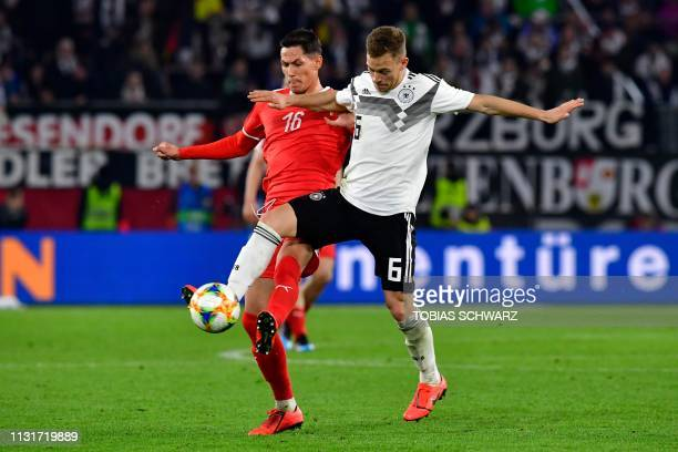 Germany's midfielder Joshua Kimmich and Serbia's midfielder Sasa Lukic vie for the ball during the friendly football match Germany v Serbia in...