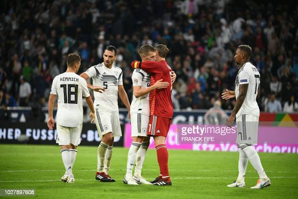 Germany's midfielder Joshua Kimmich Germany's defender Mats Hummels Germany's defender Matthias Ginter Germany's goalkeeper Manuel Neuer and...