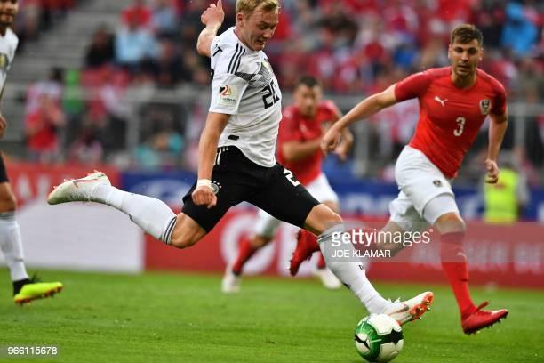Germany's midfielder Julian Brandt shoots during the international friendly footbal match Austria v Germany in Klagenfurt Austria on June 2 2018