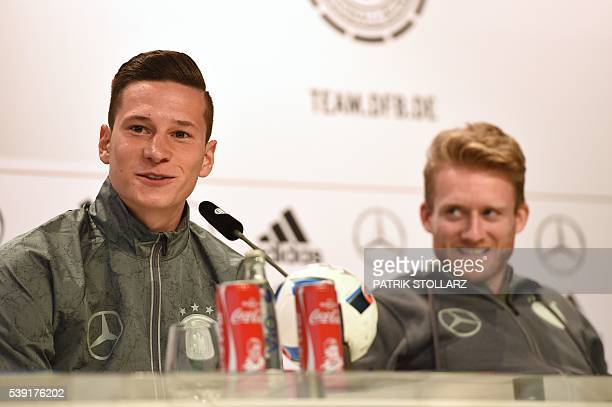 Germany's midfielder Julian Draxler and Germany's midfielder Andre Schuerrle address a press conference at the team's training ground in...