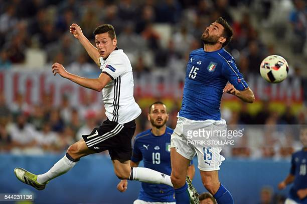 Germany's midfielder Julian Draxler and Italy's defender Andrea Barzagli jump for the ball during the Euro 2016 quarterfinal football match between...
