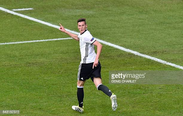 Germany's midfielder Julian Draxler celebrates after scoring during the Euro 2016 round of 16 football match between Germany and Slovakia at the...