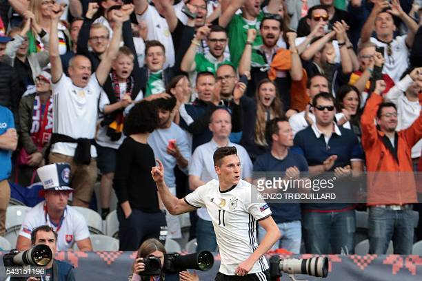 Germany's midfielder Julian Draxler celebrates after scoring his team's third goal during the Euro 2016 round of 16 football match between Germany...