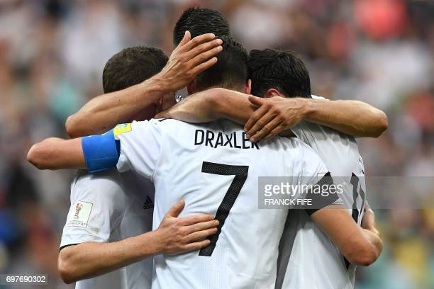 TOPSHOT Germany's midfielder Julian Draxler celebrates with team mates after scoring a penalty during the 2017 Confederations Cup group B football...