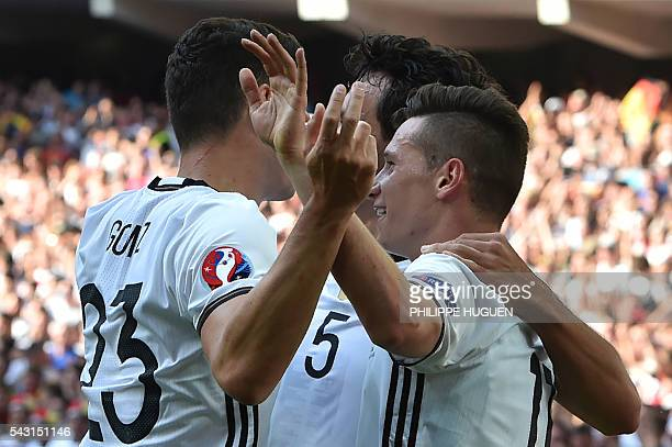 Germany's midfielder Julian Draxler celebrates with teammates after scoring during the Euro 2016 round of 16 football match between Germany and...