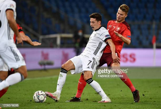 Germany's midfielder Julian Draxler fights for the ball with Switzerland's defender Nico Elvedi during the UEFA Nations League league A day 2 group 4...