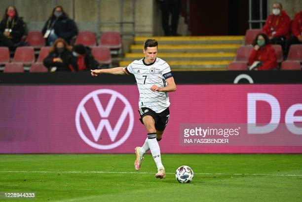 Germany's midfielder Julian Draxler runs with the ball during the international friendly football match Germany v Turkey in Cologne, on October 7,...