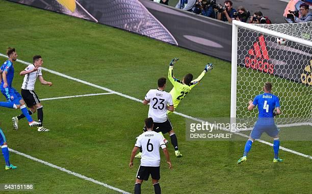 Germany's midfielder Julian Draxler scores against Slovakia's goalkeeper Matus Kozacik during the Euro 2016 round of 16 football match between...