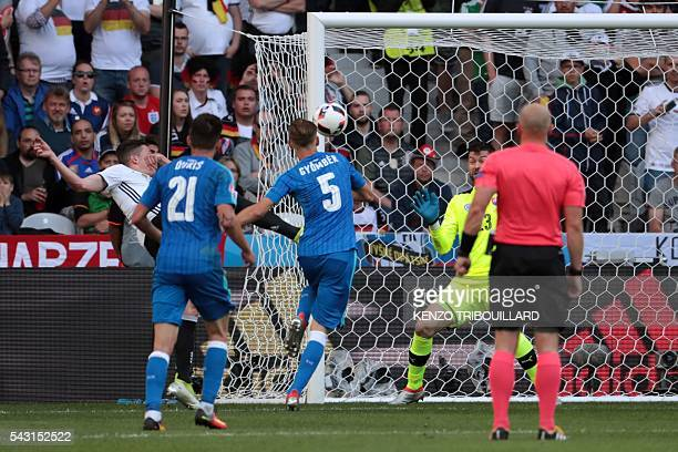 Germany's midfielder Julian Draxler scores his team's third goal during the Euro 2016 round of 16 football match between Germany and Slovakia at the...