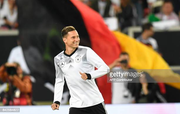 Germany's midfielder Julian Draxler warm up prior to the FIFA World Cup 2018 qualification match between Germany and Norway in the south German city...