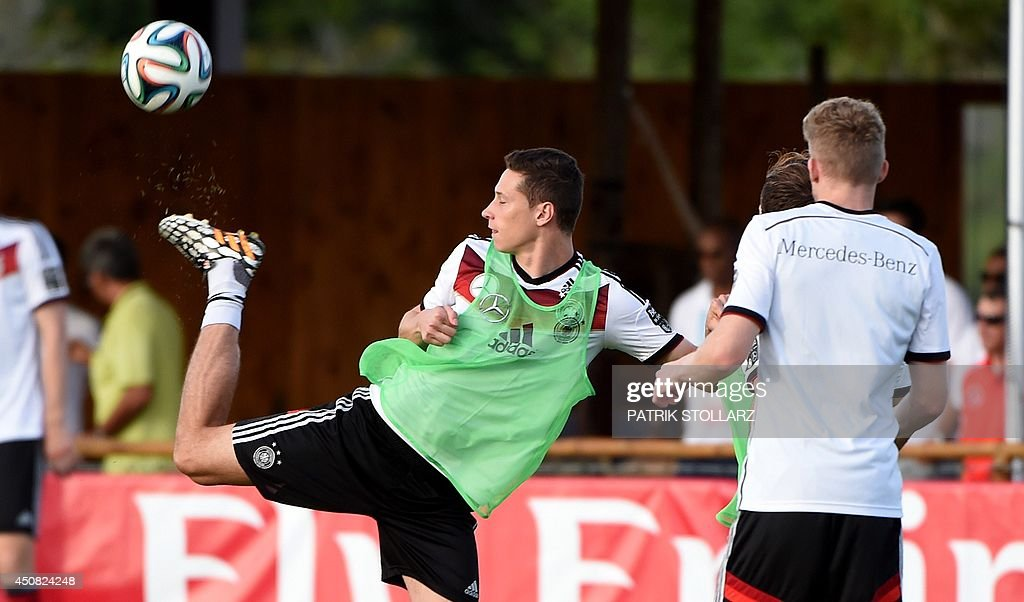 Germany's midfielder Julian Draxler (L) warms up during a training session of Germany's national football team in Santo Andre on June 18, 2014, during the 2014 FIFA World Cup football tournament.