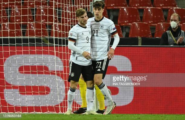 Germany's midfielder Kai Havertz celebrates scoring the 2-2 goal with his team-mate Germany's forward Timo Werner during the UEFA Nations League...