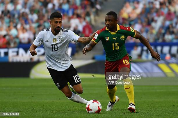 Germany's midfielder Kerem Demirbay challenges Cameroon's midfielder Sebastien Siani during the 2017 FIFA Confederations Cup group B football match...