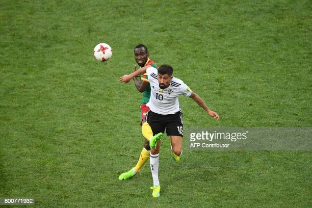 Germany's midfielder Kerem Demirbay heads the ball with Cameroon's forward Nicolas Ngamaleu during the 2017 FIFA Confederations Cup group B football...