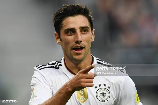 Germany's midfielder Lars Stindl celerate after scoring te first goal during the 2017 Confederations Cup final football match between Chile and...
