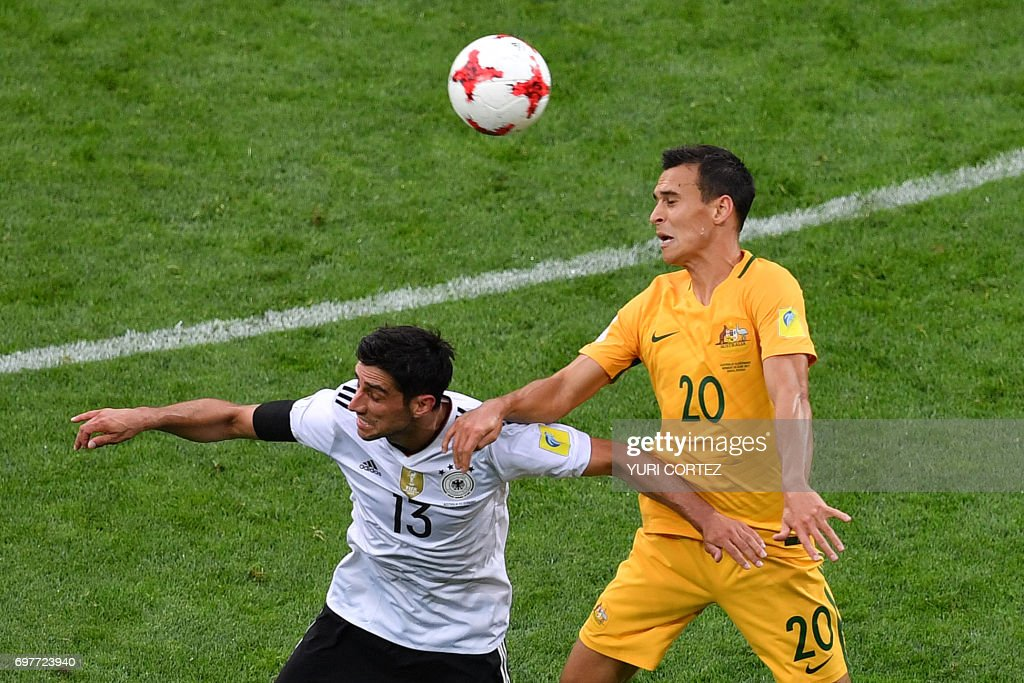 Germany's midfielder Lars Stindl (L) heads the ball with Australia's defender Trent Sainsbury during the 2017 Confederations Cup group B football match between Australia and Germany at the Fisht Stadium in Sochi on June 19, 2017. / AFP PHOTO / Yuri CORTEZ