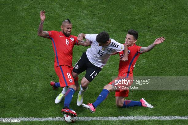 TOPSHOT Germany's midfielder Lars Stindl vies with Chile's midfielder Arturo Vidal and Chile's midfielder Charles Aranguiz during the 2017...