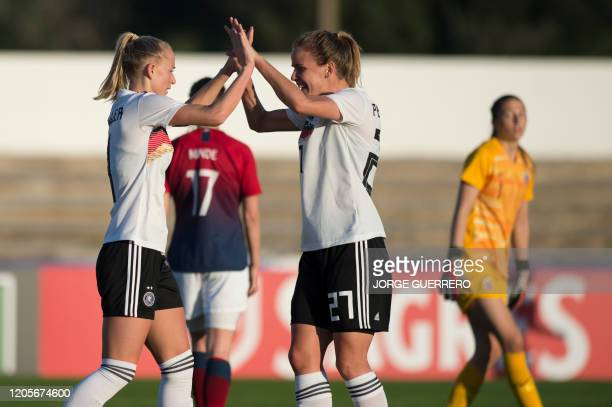 Germany's midfielder Lea Schuller celebrates her goal with forward Lena Petermann during the Algarve Cup semifinal football match between Germany and...