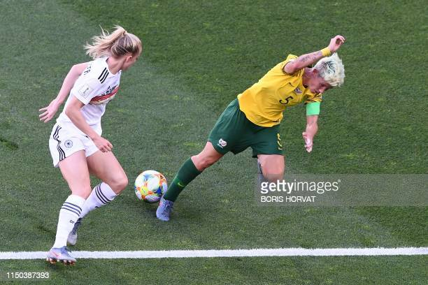 Germany's midfielder Lea Schuller vies for the ball with South Africa's defender Janine Van Wyk during the France 2019 Women's World Cup Group B...