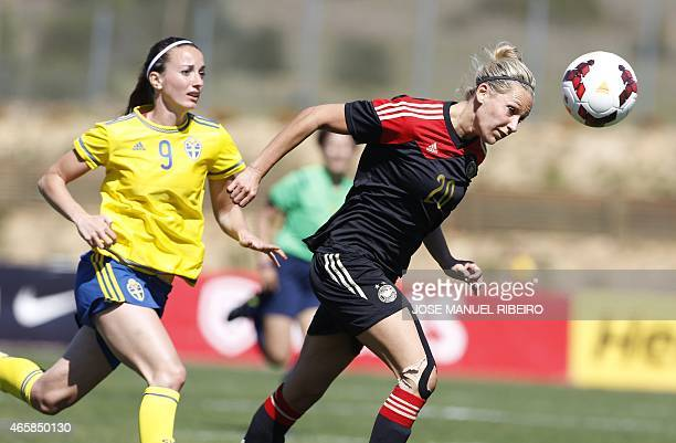 Germany's midfielder Lena Goebling heads the ball beside Sweden's forward Kosovare Asllani during the Algarve Cup semifinal football match Sweden vs...