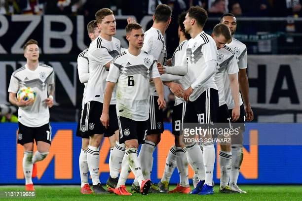Germany's midfielder Leon Goretzka celebrates scoring the 11 equaliser with his teammates during the friendly football match Germany v Serbia in...