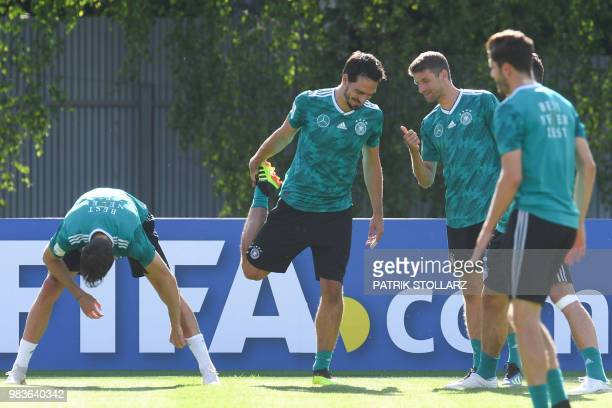 Germany's midfielder Leon Goretzka chats with forward Thomas Mueller during a training session in Vatutinki on June 25 during the Russia 2018 World...