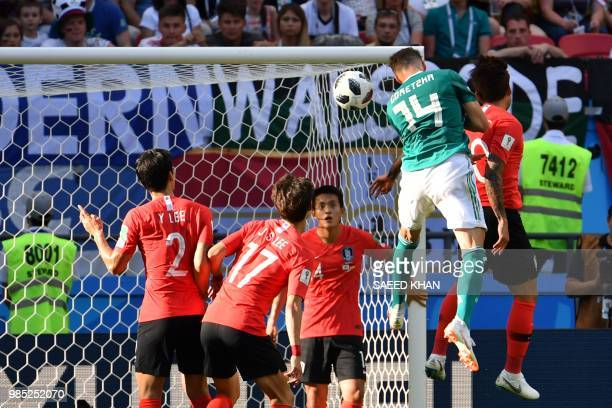 Germany's midfielder Leon Goretzka jumps to head the ball during the Russia 2018 World Cup Group F football match between South Korea and Germany at...