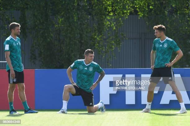 Germany's midfielder Leon Goretzka midfielder Toni Kroos and forward Thomas Mueller attend a training session in Vatutinki on June 25 during the...