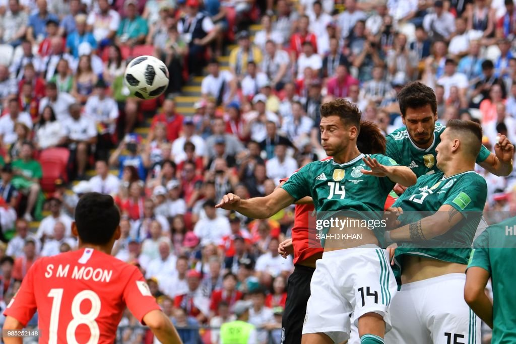 Germany's midfielder Leon Goretzka (3rd R) reacts after heading the ball during the Russia 2018 World Cup Group F football match between South Korea and Germany at the Kazan Arena in Kazan on June 27, 2018. (Photo by SAEED KHAN / AFP) / RESTRICTED