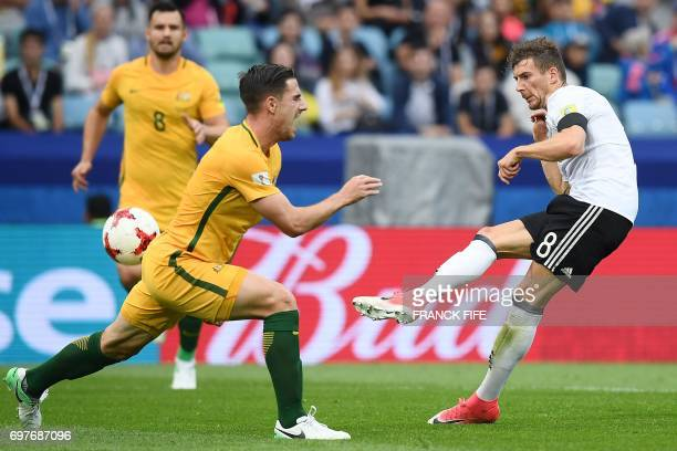 TOPSHOT Germany's midfielder Leon Goretzka shoots the ball past Australia's defender Milos Degenek during the 2017 Confederations Cup group B...