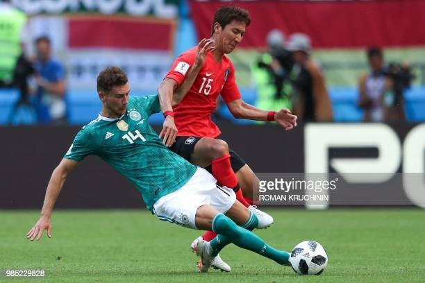 TOPSHOT Germany's midfielder Leon Goretzka vies for the ball with South Korea's midfielder Jung Wooyoung during the Russia 2018 World Cup Group F...
