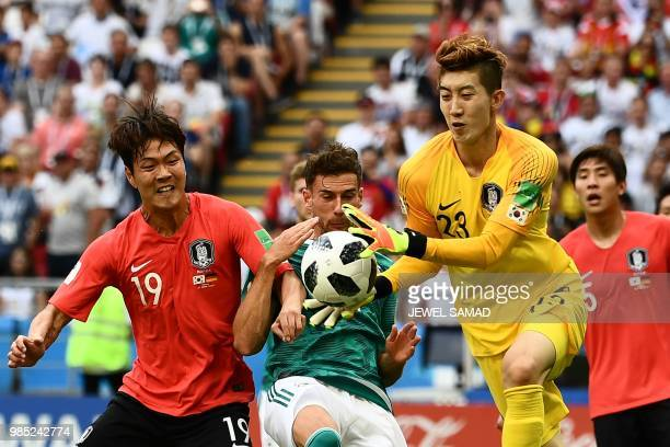 TOPSHOT Germany's midfielder Leon Goretzka vies for the ball with South Korea's defender Kim Younggwon and South Korea's goalkeeper Cho Hyunwoo...