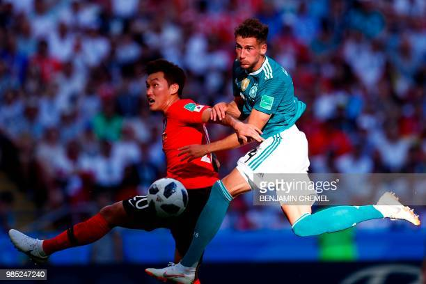 Germany's midfielder Leon Goretzka vies for the header with South Korea's defender Jang Hyunsoo during the Russia 2018 World Cup Group F football...
