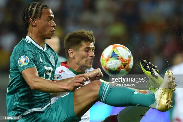 Germany's midfielder Leroy Sane and Belarus' defender Aleksandr Martynovich vie for the ball during the Euro 2020 football qualification match...