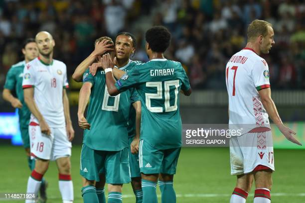 Germany's midfielder Leroy Sane celebrates with teammates after scoring the opening goal during the Euro 2020 football qualification match between...