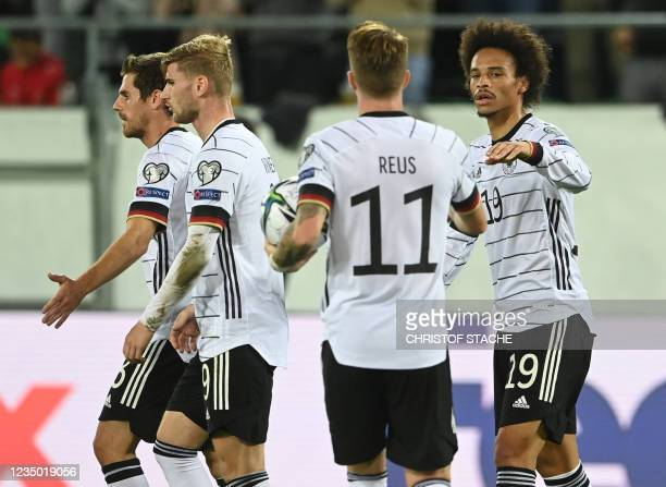 Germany's midfielder Leroy Sane celebrates with teammates scoring during the FIFA World Cup Qatar 2022 qualification Group J football match between...
