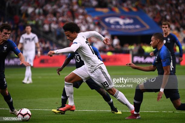 Germany's midfielder Leroy Sane is chased by France's midfielder Kylian Mbappe during the UEFA Nations League football match between France and...