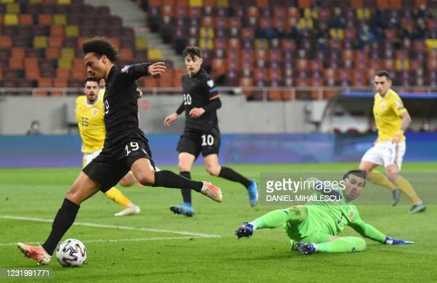 Germany's midfielder Leroy Sane misses to score past Romania's goalkeeper Florin Nita during the FIFA World Cup Qatar 2022 qualification football...