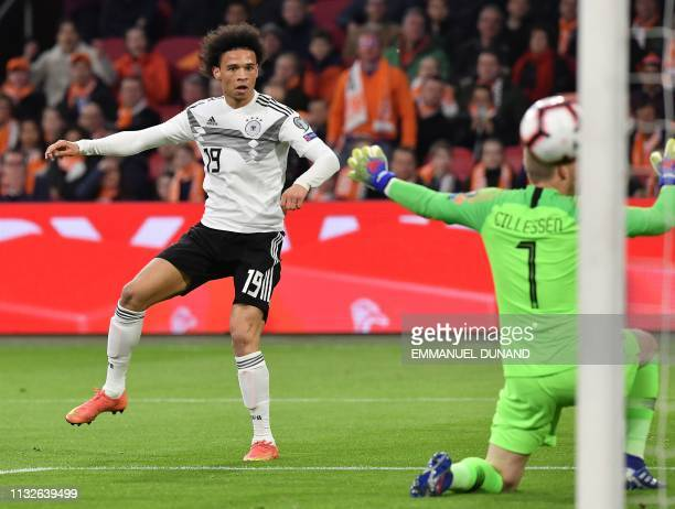 Germany's midfielder Leroy Sane scores their opener during the UEFA Euro 2020 Group C qualification football match between The Netherlands and...