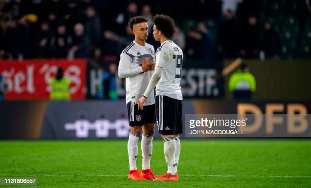 Germany's midfielder Leroy Sane speaks to Germany's defender Thilo Kehrer at the end of the friendly football match Germany v Serbia in Wolfsburg...