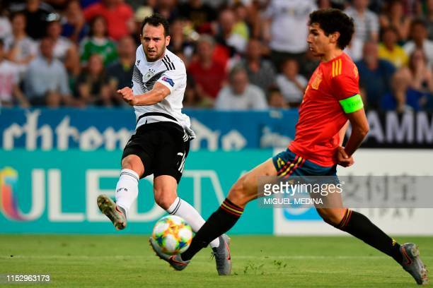Germany's midfielder Levin Oeztunali centres past Spain's defender Jesus Vallejo during the final match of the UEFA U21 European Football...