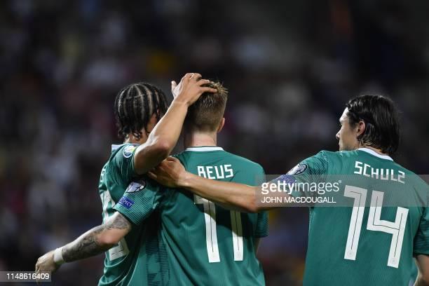 Germany's midfielder Marco Reus celebrates with Germany's midfielder Leroy Sane and Germany's defender Nico Schulz after scoring the team's second...