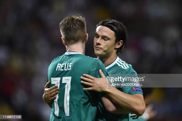 Germany's midfielder Marco Reus celebrates with teammates after scoring a goal during the Euro 2020 football qualification match between Belarus and...