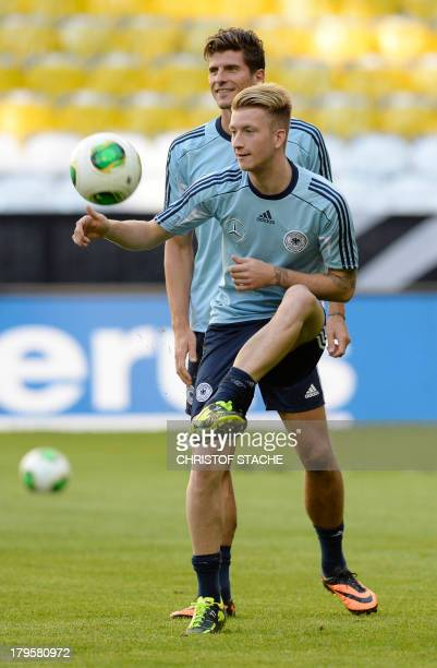 Germany's midfielder Marco Reus controls the ball in front of Germany's striker Mario Gomez during the final training's session of the German...