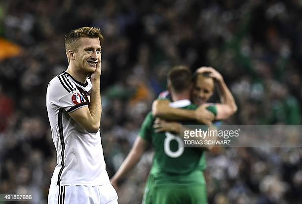 Germany's midfielder Marco Reus reacts after losing a UEFA Euro 2016 Group D qualifying football match between Germany and Ireland at the Aviva...
